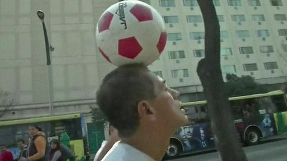 Man walks 1,200 miles for peace with ball on head