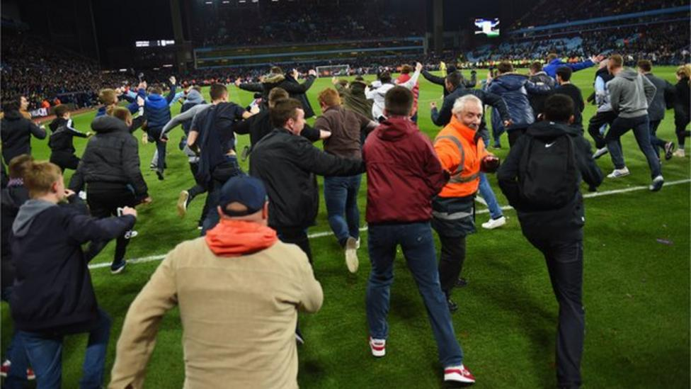 Fans invade pitch during Aston Villa game