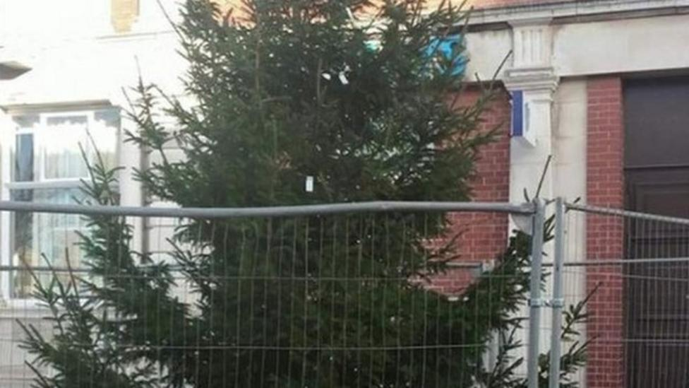 Christmas tree goes up in April
