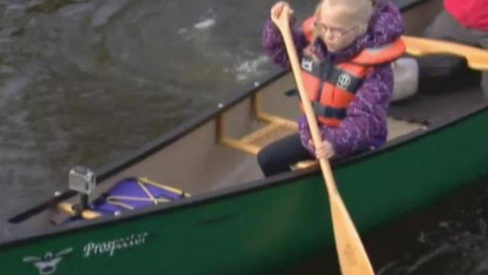 Girl who canoes to school