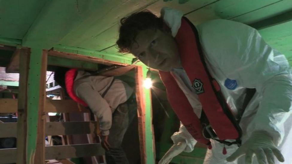 On board migrant boat in Mediterranean