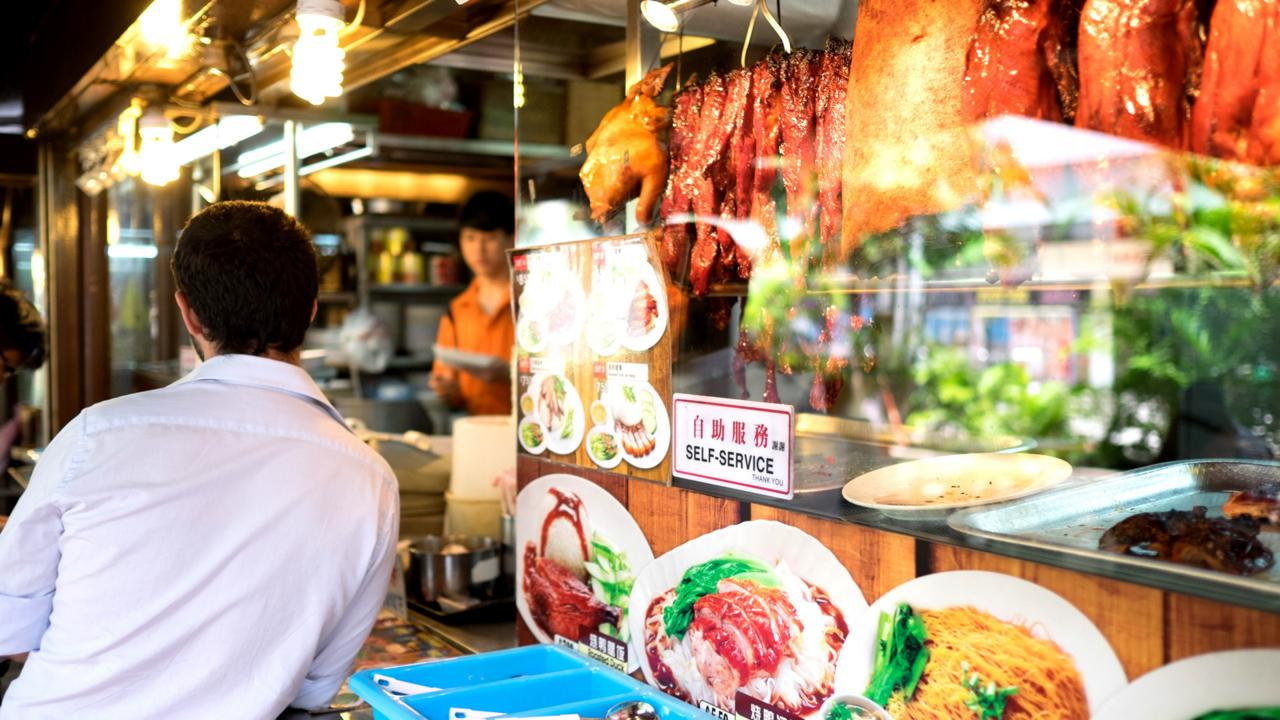 It's easy to find chicken rice at street food stalls, such as this one on Orchard Road (Credit: Credit: Phillip Bond/Alamy)