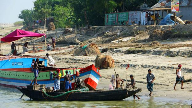Travelling between villages in Bangladesh often requires a boat (Credit: Credit: Mike MacEacheran)