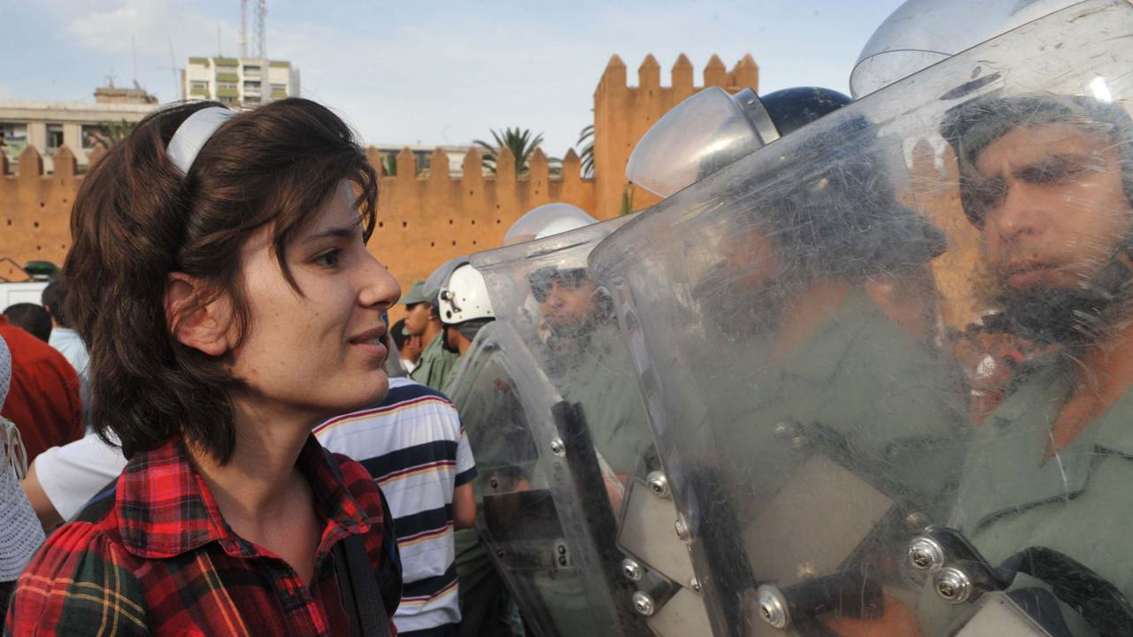 Nonviolent protests are more likely to attract support from across society. Here a pro-reform protestor faces security forces in Morocco in 2011 (Credit: Getty Images)