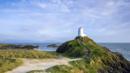 Llanddwyn's spectacular coastline draws visitors (Credit: Credit: Loop Images/Getty Images)
