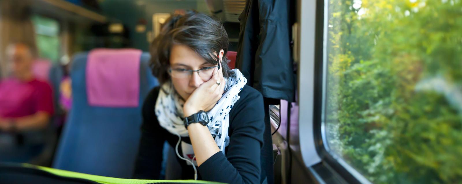 woman commuter train laptop