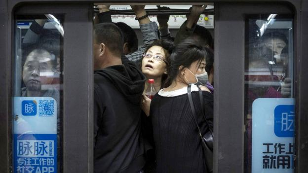 The gruelling, six-hour commute of Beijing's workers