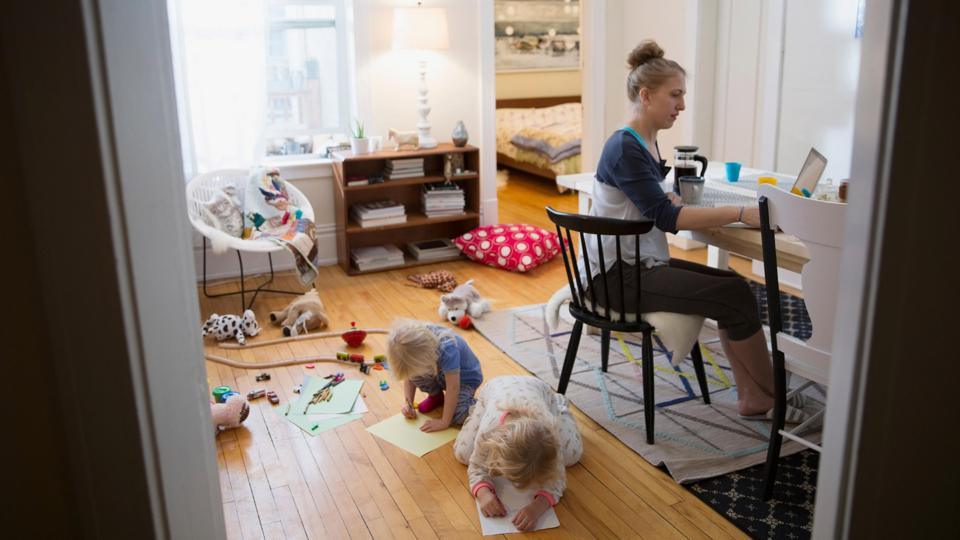 Woman working at home with kids