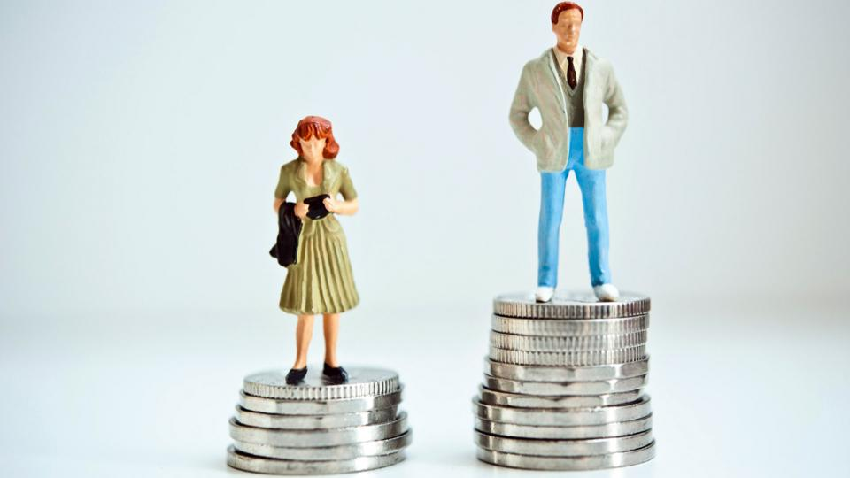 Pay gap illustrated with coins and figurines