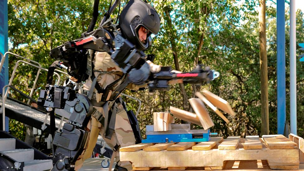 Warrior web is different from the tough exoskeletons being developed, like Raytheon's XOS 2, which allow soldiers to carry heavy weights. (Copyright: Raytheon)