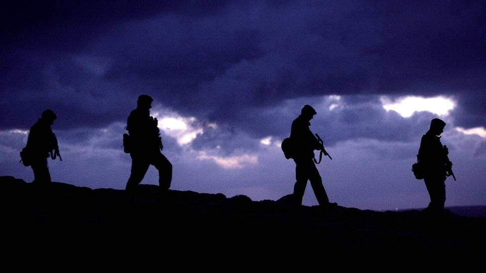 Soldiers walking in silhouette (Copyright: Getty Images)