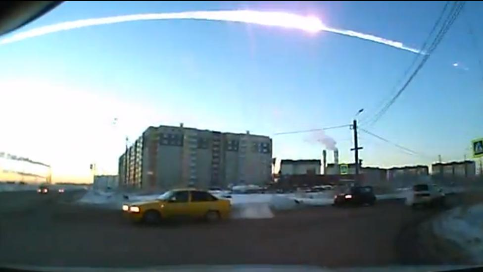 A meteor crashing in the Urals in Russia has reportedly injured at least 400 people. Several people captured it on dashboard cams. (Credit: YouTube/Андрей Борисович Королев)