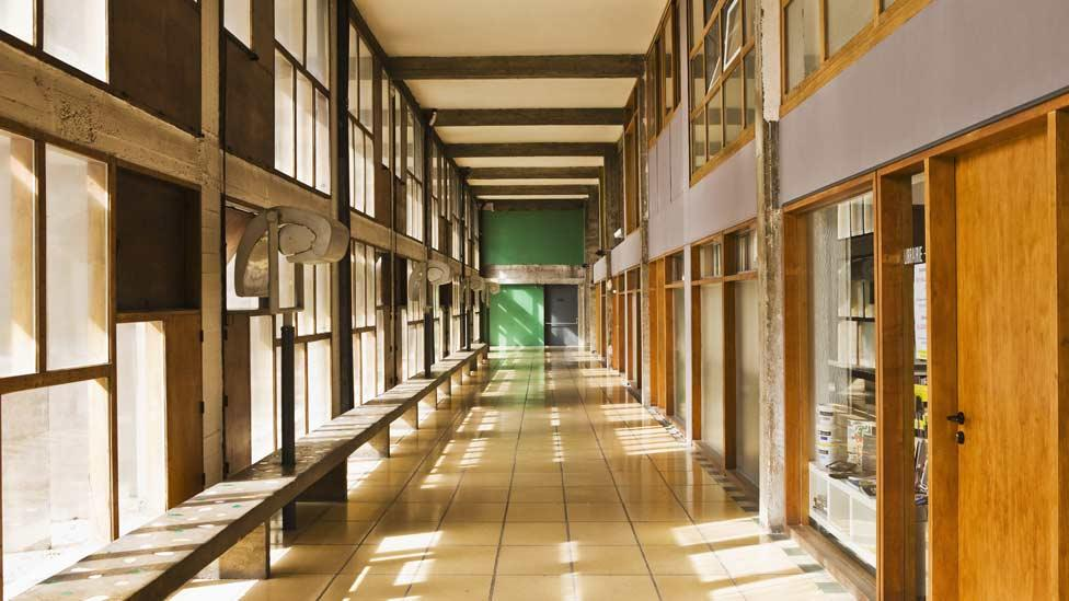 """Inside, the apartments are arranged around wide central corridors which Le Corbusier envisioned as """"vertical cities"""". (Corbis)"""