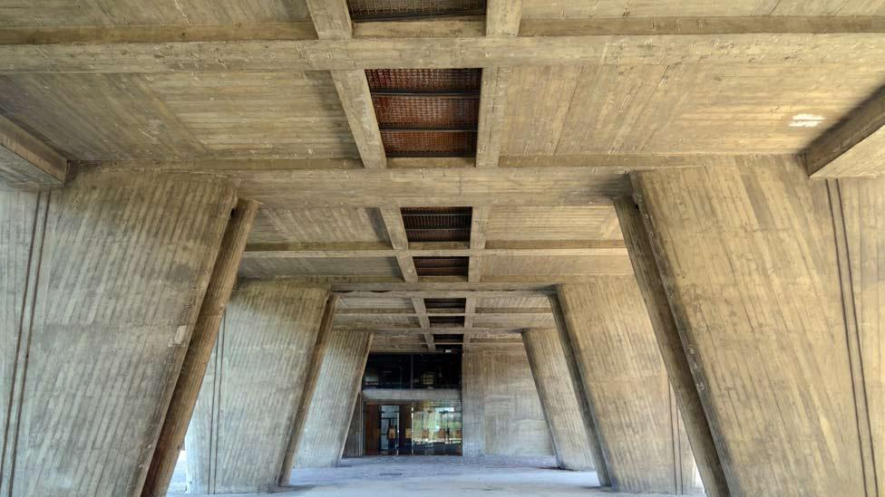 The building is perched on vast, tapered concrete legs known as 'piloti' which increase the building's imposing stature, creating additional space underneath. (Corbis)