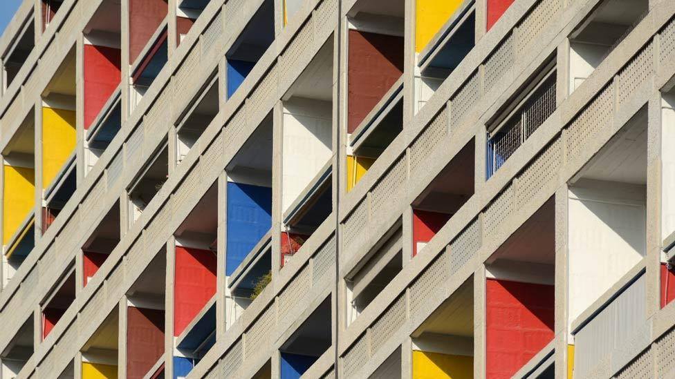 Each living unit was designed as an autonomous space, with double-height living rooms and deep balconies in bright colours contrasting with the plain concrete facade. (Corbis)