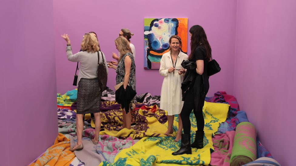 Visitors walk around inside an installation by Norwegian artist Bjarne Melgaard, exhibited by Gavin Brown's Enterprise. (John Berens/ Frieze)