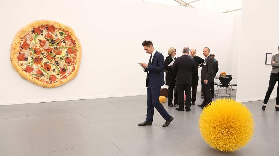 Tom Friedman's giant plaster pizza, Untitled (Pizza), 2013, was sold by Luhring Augustine for $270,000. (Zuma/Rex Features)