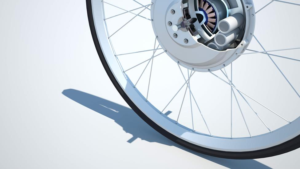 The Greenwheel turns any pedal-powered cycle into an electric one by fitting a special electric motor wheel. The bike is recharged through pedalling or the mains. (Copyright: MIT)