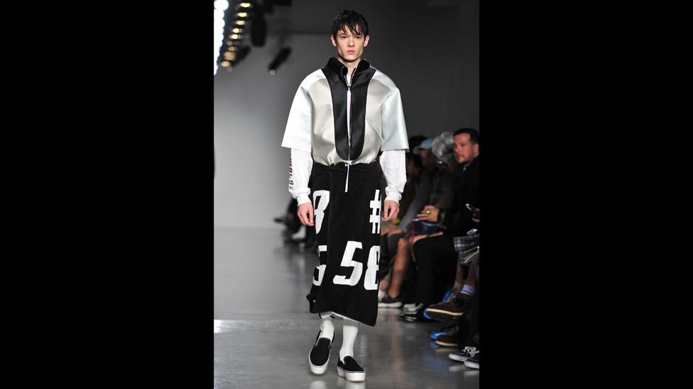 Another London up-and-comer, Shaun Sampson, showed pale pink organza board shorts and 'skirts' made to look like beach towels. (Rex Features)