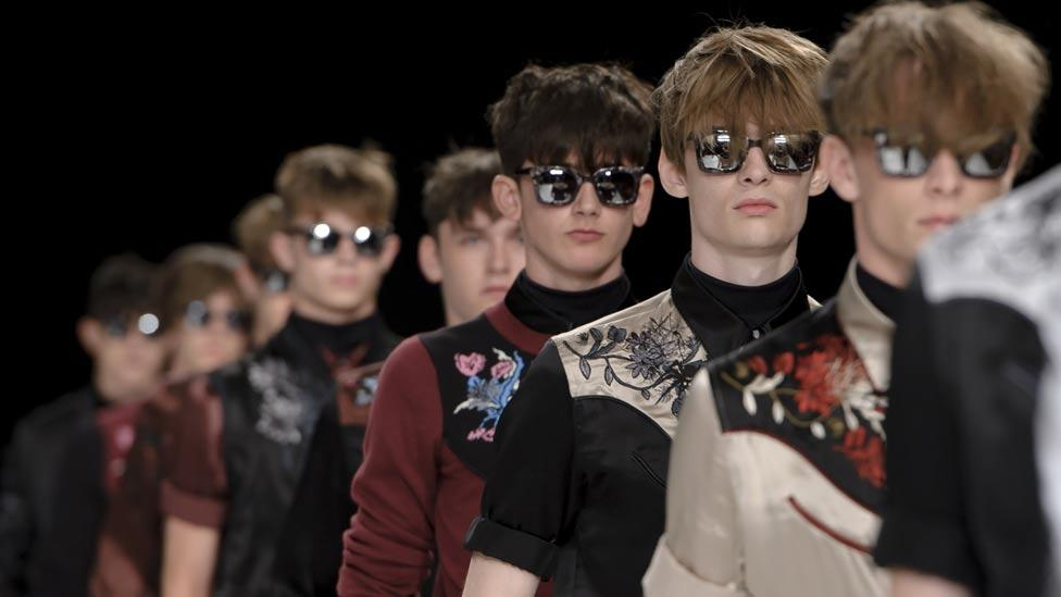 The Topman show featured fanciful cowboys in embroidered florals. (Associated Press)