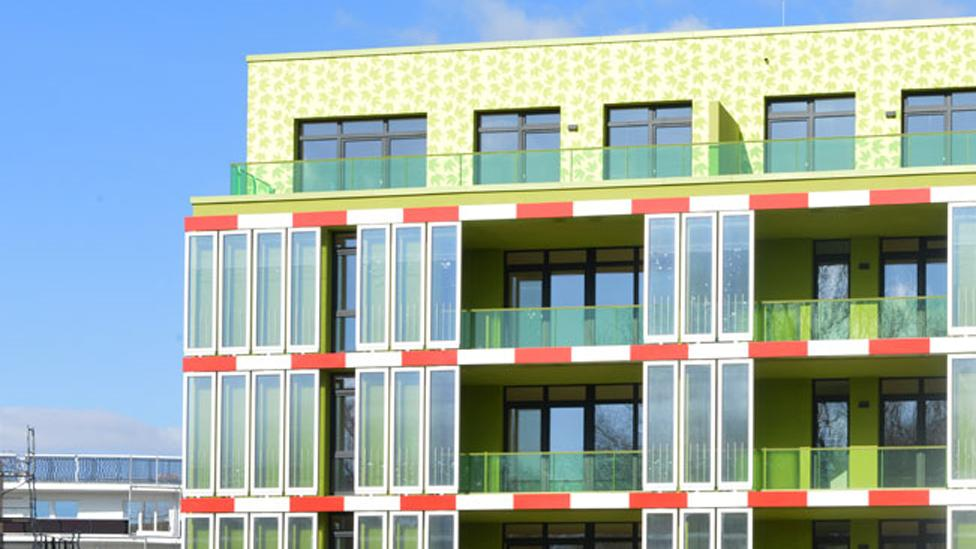 """In Germany, this  building has become the world's first to have a """"bio-reactor facade"""" – panels filled with algae which produce energy and can cool the interior. (Copyright: IBA)"""