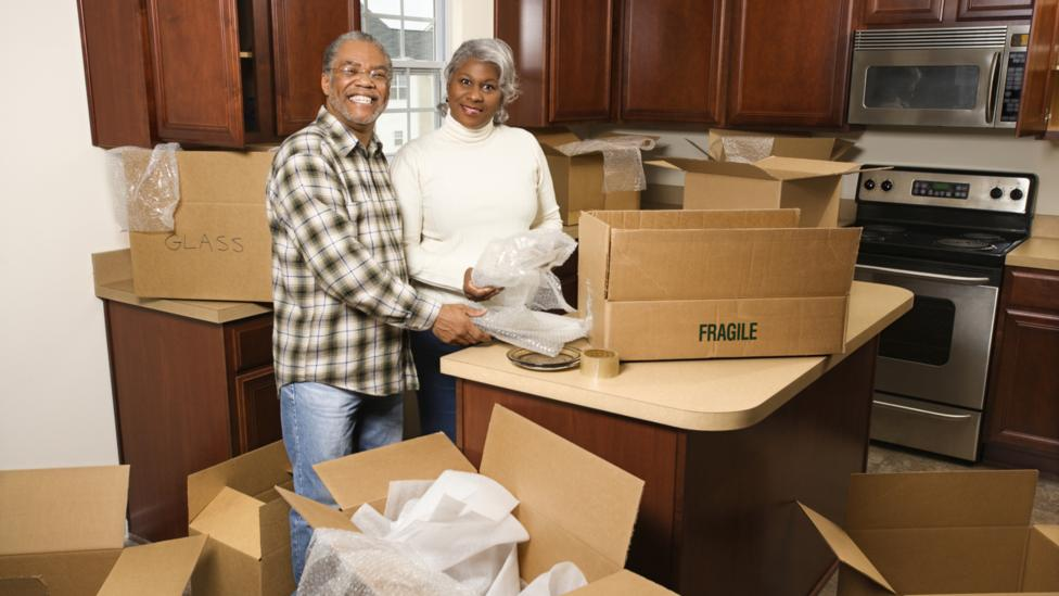 Experts say moving to a smaller space – and unloading unwanted items – can be a great cost-saving measure for empty nesters. (Thinkstock)