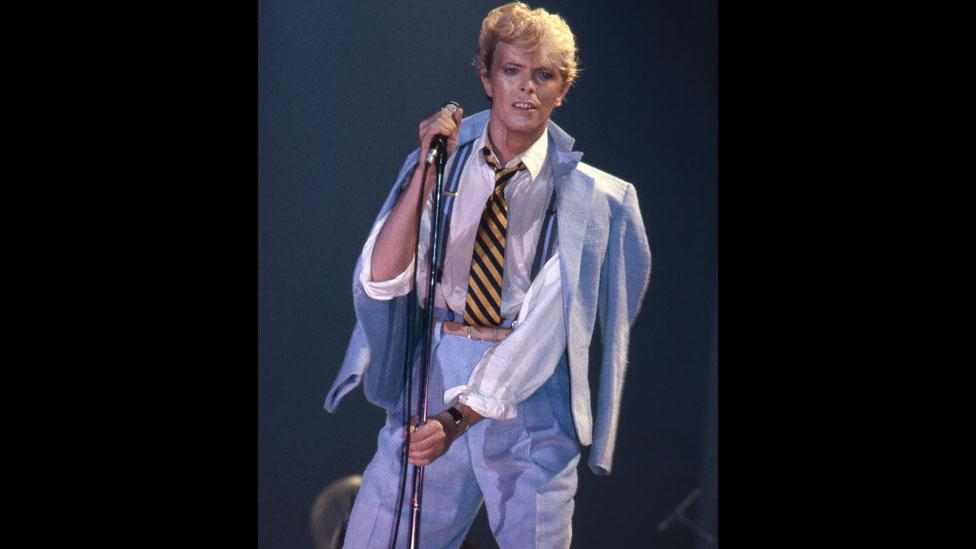 The singer appears suited and booted at the 1983 Serious Moonlight Tour warm-up gig in Brussels, Belgium, which followed his Let's Dance album from the same year. (Rex Features)