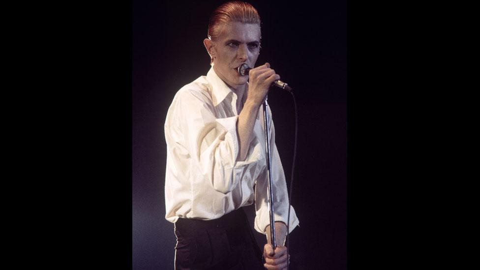 David Bowie is captured on the Station to Station tour in 1976, where he introduced his new Thin White Duke persona. (Rex Features)