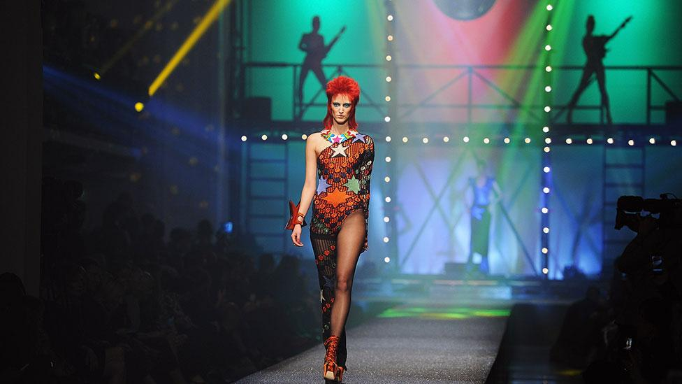 Jean-Paul Gaultier cited David Bowie as an inspiration for his Paris Spring/Summer 2013 show, sending Bowie lookalikes down the runway. (Getty Images)