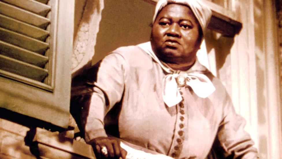 Hattie McDaniel was the first African-American to win an Oscar when she played Mammy in the film. But some criticised the role for affirming a racial stereotype. (Rex Features)