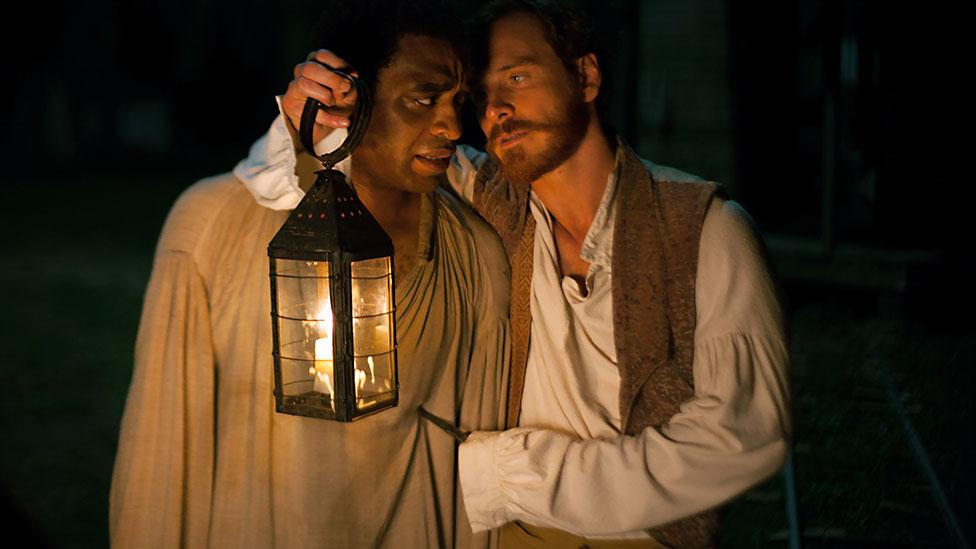 A new film, 12 Years a Slave, stars Chiwetel Ejiofor as a free man who is sold into slavery. Michael Fassbender plays a cruel plantation owner. (Fox Searchlight)