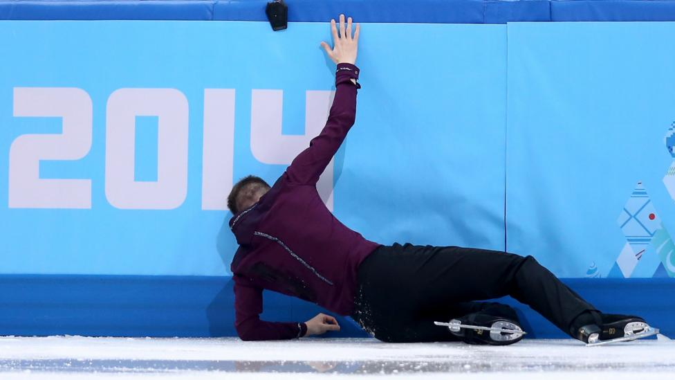 US figure skater Jeremy Abbott gets up after a nasty fall during his short program at the 2014 Winter Olympics in Sochi, Russia. (Matthew Stockman/Getty Images)