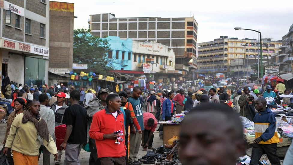 Kenyans throng a Nairobi suburb on market day (Tony Karumba /AFP/Getty Images)