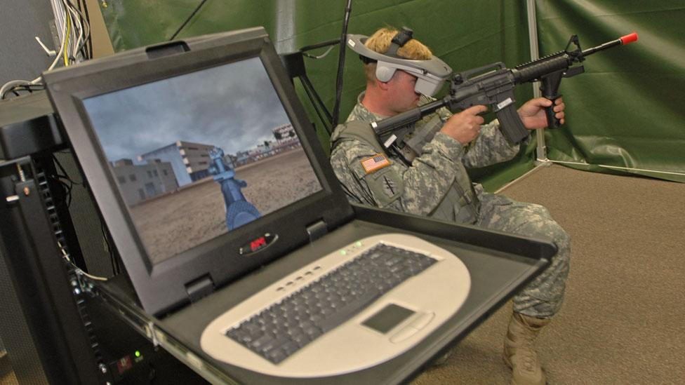 A soldier uses the Virtual Squad Training System at Schofield Barracks in Fort Shafter in Wahiawa, Hawaii. (Lucy Pemoni/Getty Images)