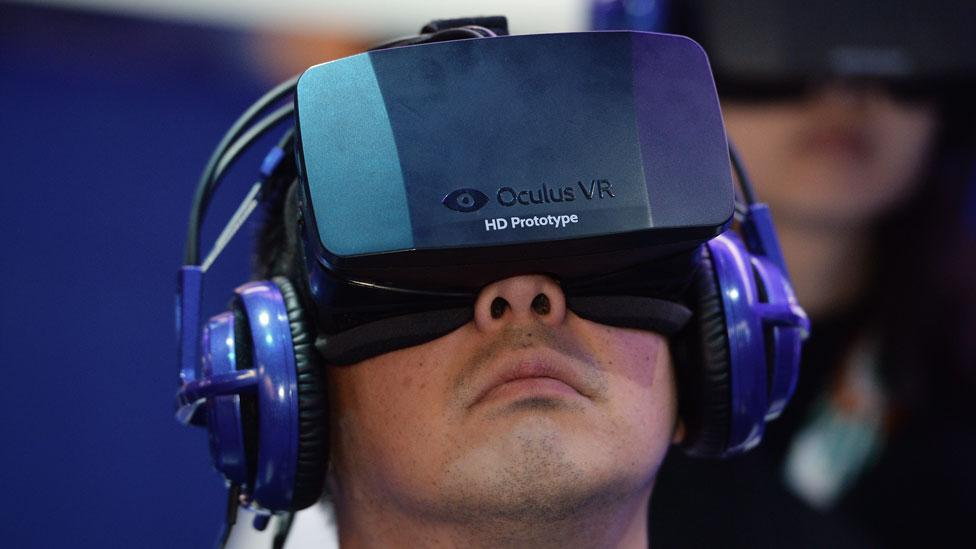 The Oculus Rift virtual reality device displaying a multiplayer dog-fighting shooter game (Robyn Beck/AFP/Getty Images)