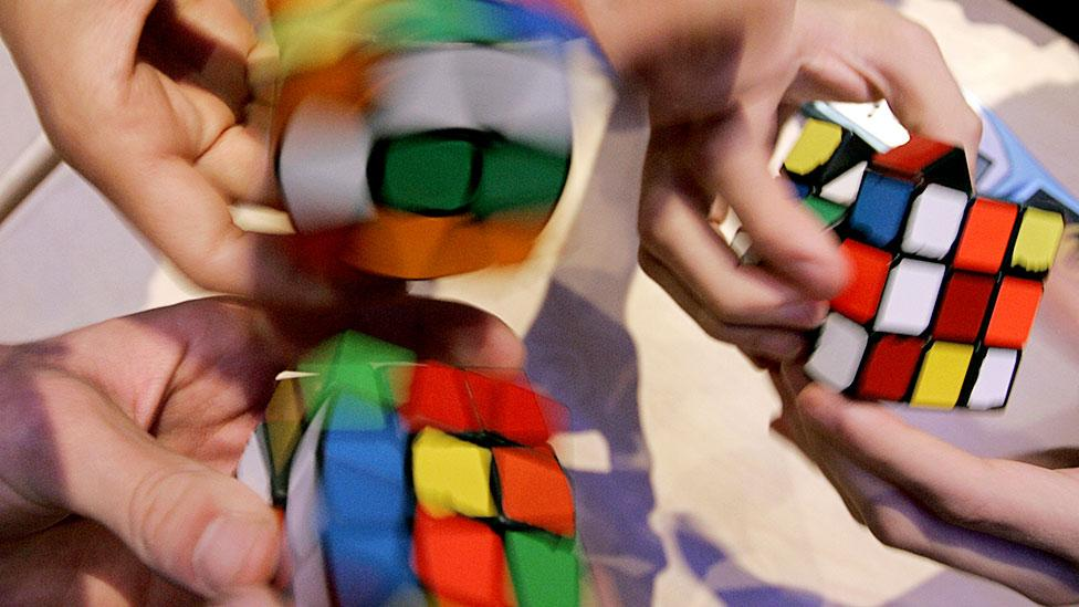 Speedcubers try to solve Rubik's Cubes as quickly as possible, sometimes in organised tournaments. The current record is 5.55 seconds. (Karoly Arvai/Reuters/Corbis)