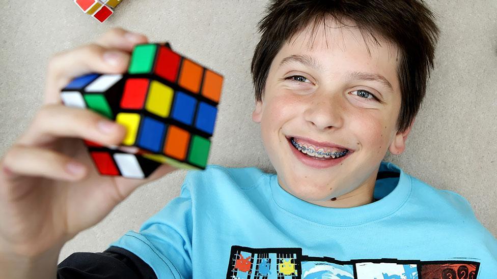 Australian Feliks Zemdeg, seen here aged 13, is one such Speedcuber. Now 18, he holds the one-handed solving record of 9.03 seconds. (Rebecca Michael/Newspix/Rex)