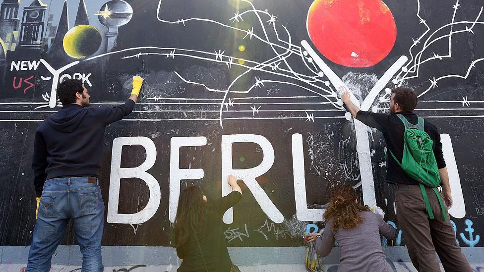 Volunteers maintain the murals of Berlin's East Side Gallery. (Adam Berry/Getty Images)