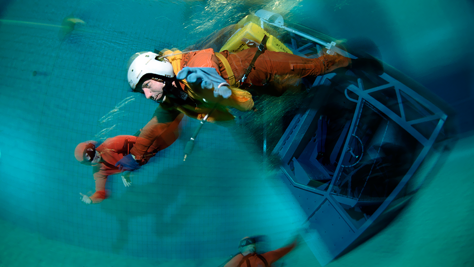 Breath-holding is part of the training for some jobs: a pilot practises escaping from a submerged aircraft cockpit in Brest, France. (Science Photo Library)