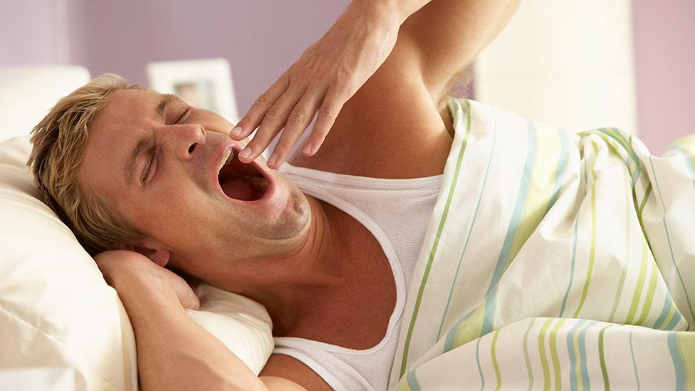 Does infectious yawning ensure that we all go to bed at the same time? (Getty Images)