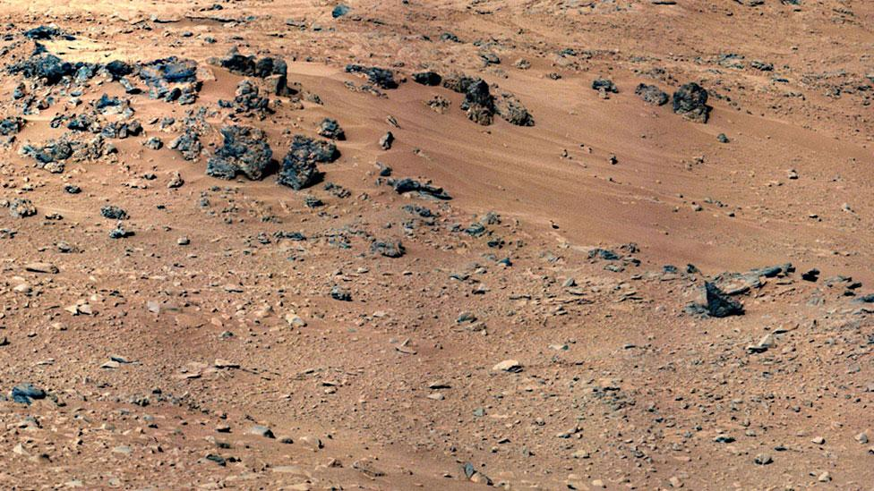 Colonists could use the rocks from the Red Planet's surface to help build shelters (Nasa)