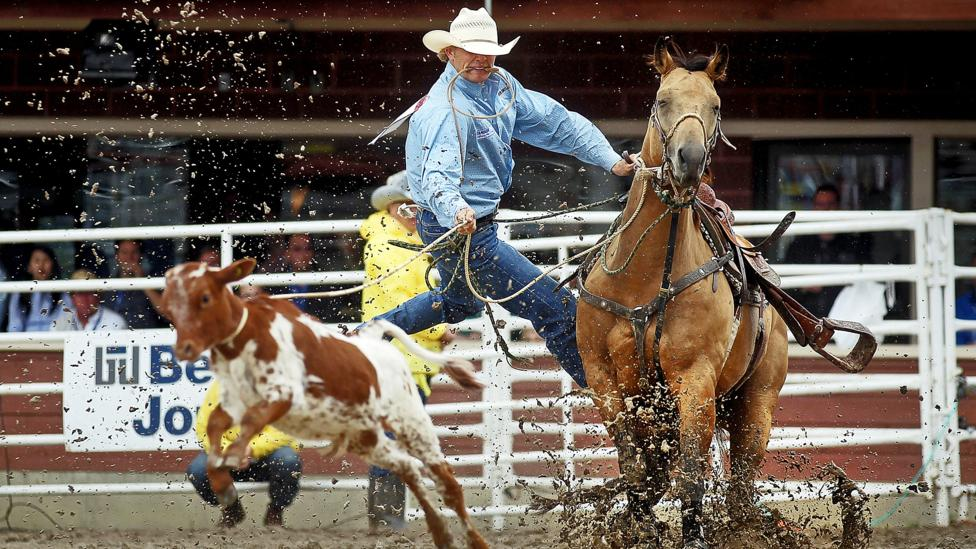 The Calgary Stampede is Canada's largest annual rodeo and draws more than one million visitors. (Credit: Mario Tama/Getty Images)