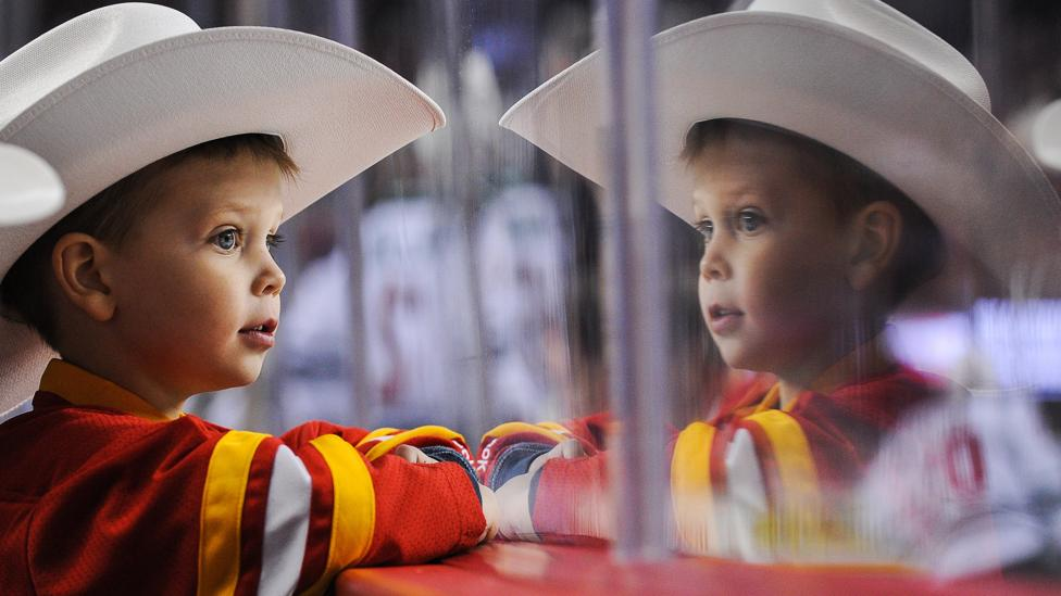 Fans of the Calgary Flames hockey team start early. (Credit: Derek Leung/Getty Images)
