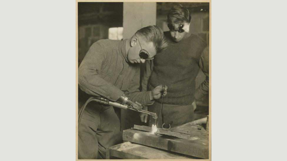 Post-WWI, new prosthetics allowed people to perform previously impossible tasks, like welding or driving a car (Credit: National Museum of Health and Medicine CC BY 2.0/Flickr)