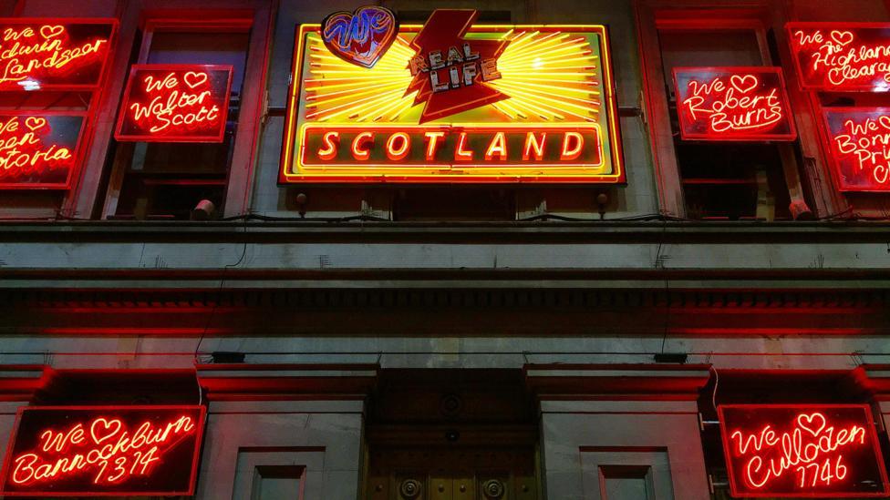 Ross Sinclair's light installation We Love Real Life Scotland is a send-up of Scottish stereotypes (Credit: Karen Gardiner)