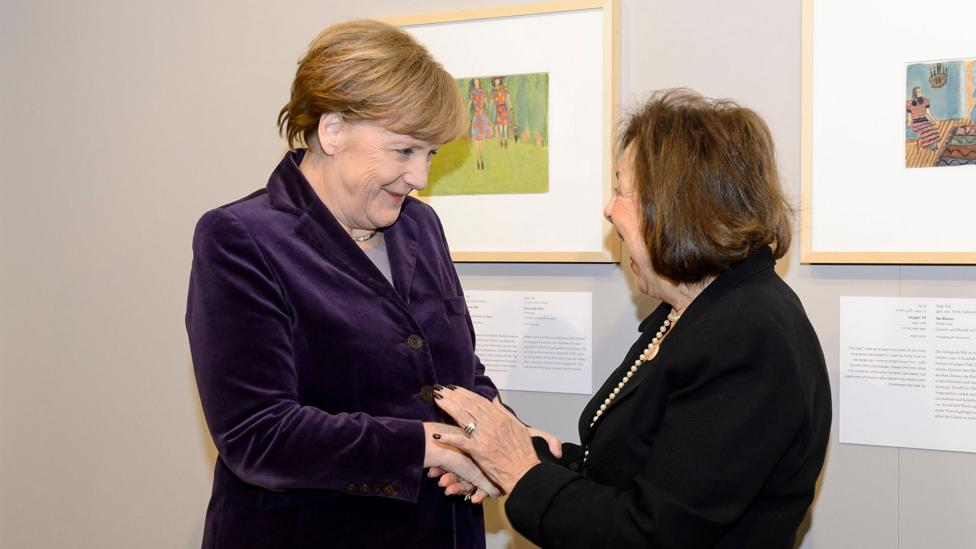 Angela Merkel was pictured with Nelly Toll in front of Girls in the Field, which Toll had painted aged 8 in a Jewish ghetto in Poland (Credit: Rex Features)