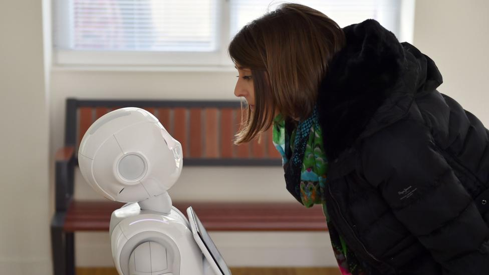 Do we really trust robots more than humans when it comes to our money? (Credit: Loic Venance /AFP/Getty Images)