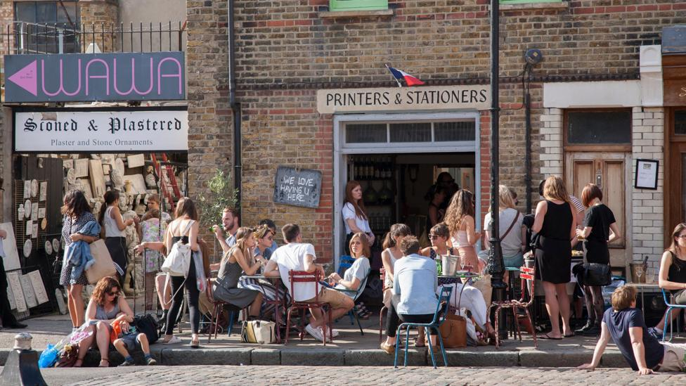 People gather at a wine bar in Shoreditch, east London (Credit: Kevin George/Alamy)