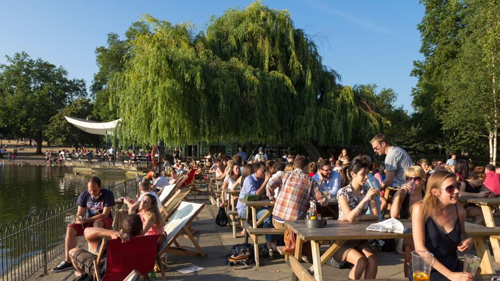 People relax on a summer day in Hyde Park (Credit: Robert Stainforth/Alamy)