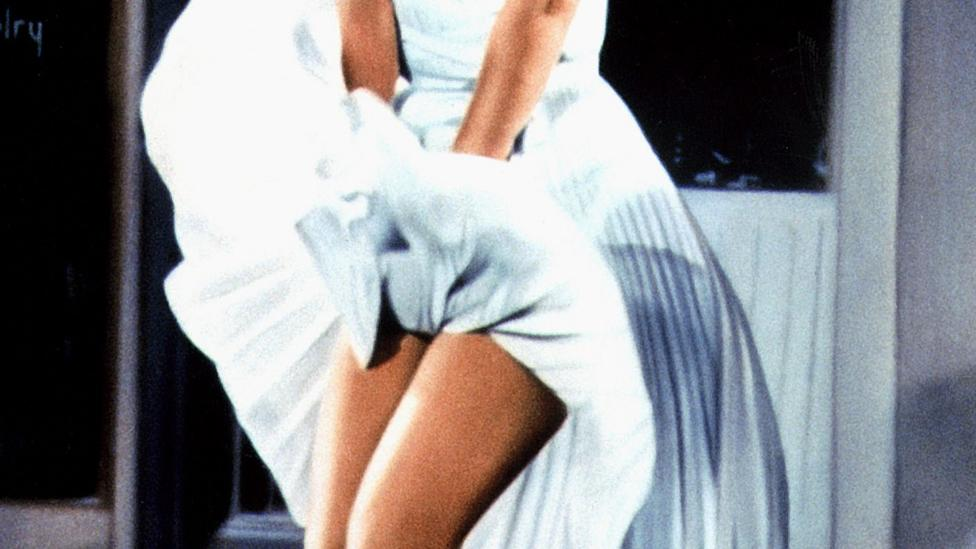 The star fusses playfully with her billowing skirt in The Seven Year Itch – but the iconic image's carefree tone is at odds with her private writing's mood (Credit: Alamy)